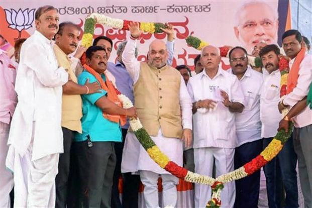 BJP president Amit Shah and the party's CM candidate B.S. Yeddyurappa. Photo: PTI