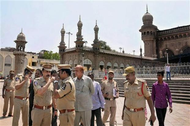 Police officials at the historic Mecca Masjid in old city of Hyderabad on Monday. Photo: PTI