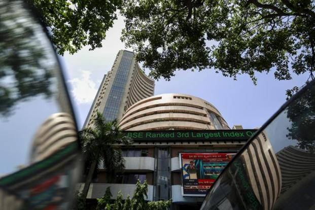 Sensex flat with positive bias; Nifty trades at 10556