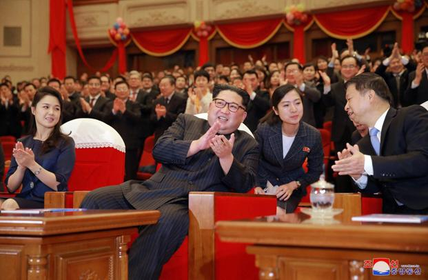 North Korean leader Kim Jong Un claps while watching a performance of a Chinese art troupe with his wife Ri Sol Ju (L) and Song Tao (R), head of Communist Party's International Department, at East Pyongyang Grand Theater on 16 April, 2018. Photo: AP