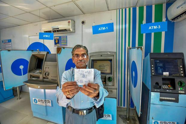 The government and RBI officials attributed the cash crunch at Automated Teller Machines (ATMs) to unusual local demand in a few states and instructed banks to improve their cash management. Photo: PTI