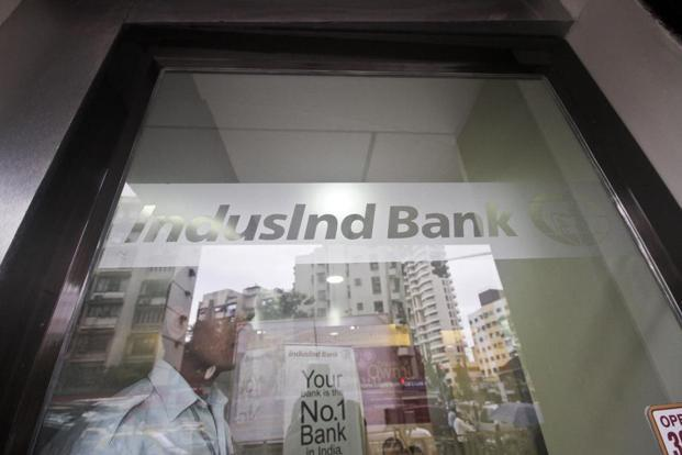 A guard stands at the entrance to an IndusInd Bank branch in Mumbai. IndusInd Bank stock was trading 0.69% down at Rs1,832 apiece on BSE in the afternoon trade on Thursday. Photo: Bloomberg