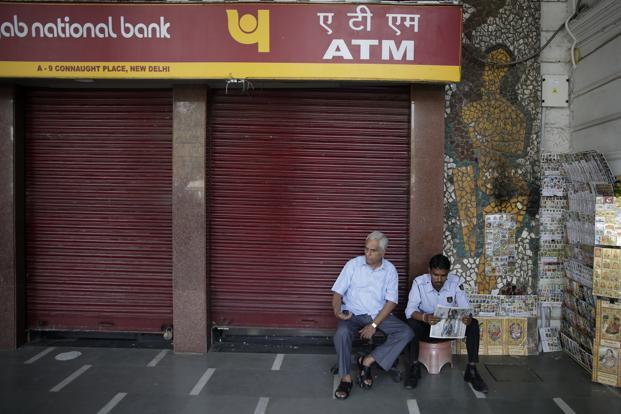 The SBI Research report says the sudden surge in currency in circulation is perplexing. Photo: AP