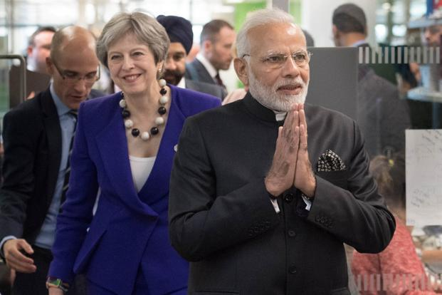 Prime Minister Narendra Modi and his British counterpart Theresa May visit the Francis Crick Institute in London, on Wednesday. Photo: Reuters