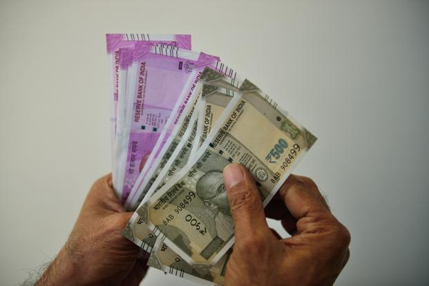 Rupee up 11 paise against dollar in early trade
