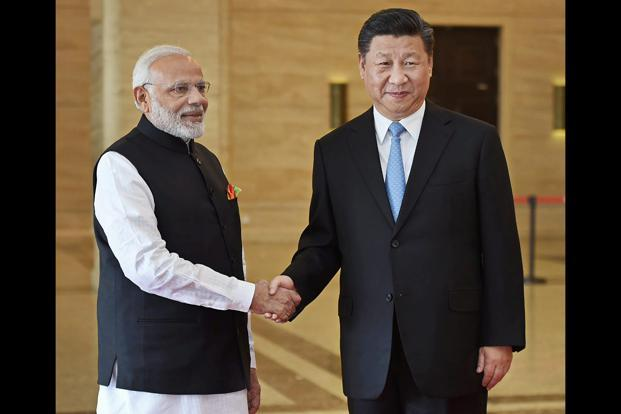 Prime Minister Narendra Modi meets Chinese president Xi Jinping during their meeting, in Wuhan, China on Friday. Photo: PTI