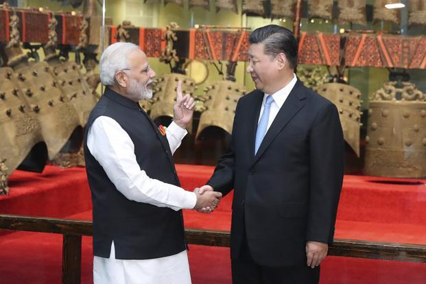 Prime Minister Narendra Modi, left, shakes hands with Chinese President Xi Jinping as they visit an exhibition of cultural relics at the Hubei Provincial Museum in Wuhan on Friday. Photo: AP