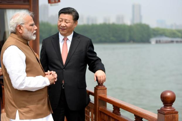 Prime Minister Narendra Modi speaks with Chinese President Xi Jinping as they take a boat ride on the East Lake in Wuhan, China on 28 April.