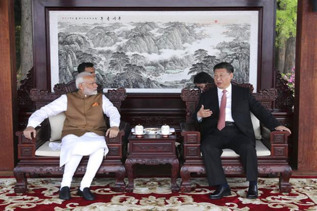 After their informal summit meeting in China for two days, Narendra Modi and Xi Jinping agreed to improve communication over military and security matters. Photo: AP