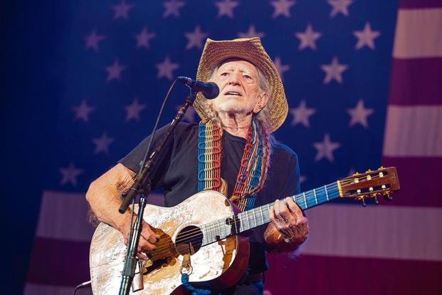 Willie Nelson performing at his annual Fourth of July picnic, 2017. Photo: Getty Images