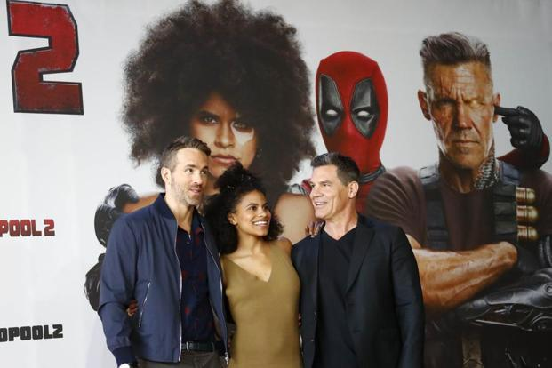 "(L-R) Cast members Ryan Reynolds, Zazie Beetz and Josh Brolin pose for a picture during a photo call for the movie ""Deadpool 2"" ahead of the premiere in Berlin, Germany May 11, 2018. Photo: Reuters"