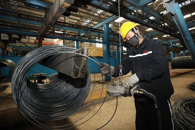 Industrial output rose 7% in April from a year earlier, the statistics bureau said Tuesday, versus a projected 6.4% in a Bloomberg survey and 6% in March. Photo: AFP