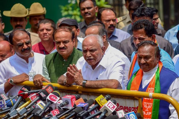 B.S. Yeddyurappa (centre) with other BJP leaders after meeting Karnataka governor Vajubhai Vala to stake claim for formation of government, in Bengaluru on Wednesday. Photo: PTI