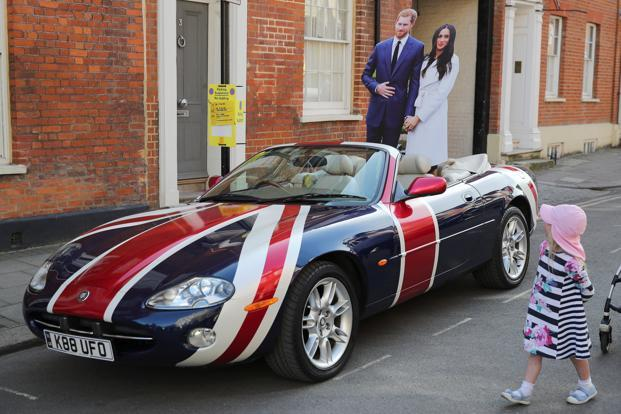 A Jaguar convertible with a Union Flag paint scheme and lifesize cardboard cut outs of Britain's Prince Harry and Meghan Markle is parked in Windsor a day before their wedding at Windsor Castle on 18 May. Photo: Reuters