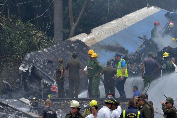 Emergency personnel work at the site of the accident after a Cubana de Aviacion aircraft crashed after taking off from Havana's Jose Marti airport on Friday. Photo: AFP