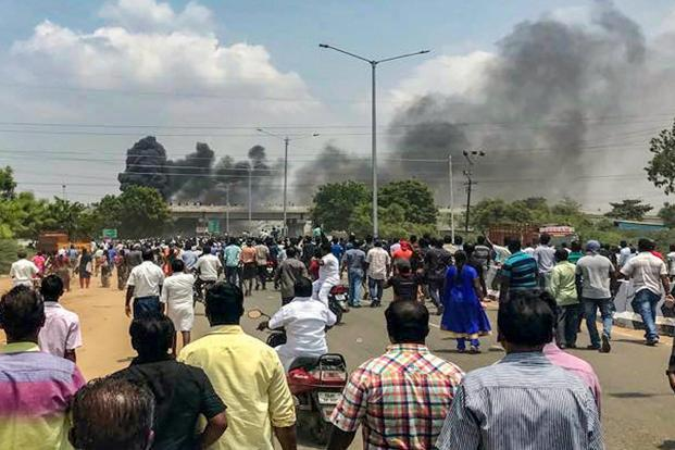 Smoke billows out of burning vehicles after a violent protest demanding closure of Vedanta's Sterlite Copper unit entered the 100th day, in Tuticorin, on Tuesday. Photo: PTI