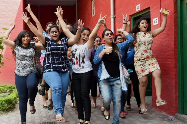 A file photo. Students celebrate after the CBSE declared Class 12 results 2018 on Saturday. Photo: PTI