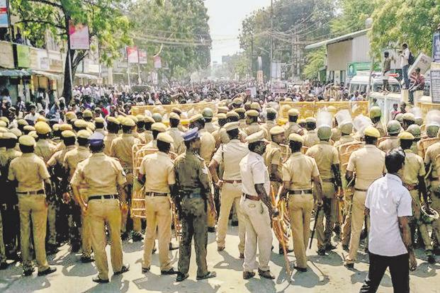 Police personnel prepare to tackle a crowd as agitators demanding closure of Vedanta's Sterlite Copper plant entered the 100th day, in Thoothukudi on Tuesday, 22 May    2018. Photo: PTI
