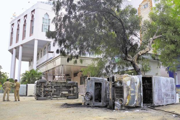 Mangled remains of vehicles outside the district collector's office after the protests. Manikandan/Mint