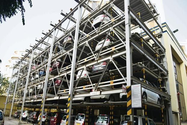 While civic bodies are being prodded to provide multi-level parkings, they must also insist on constructing parking spaces before approving building plans. Photo: Ramesh Pathania/Mint