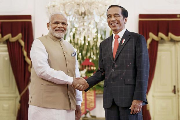 Joko Widodo and Narendra Modi also signed pacts on cooperation in the pharmaceuticals and technology industries. Photo: PTI