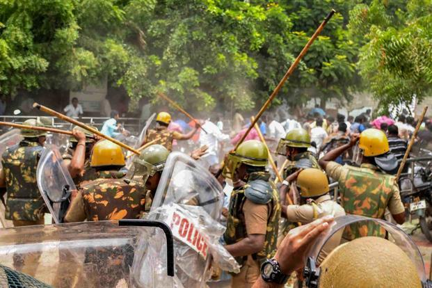 Police baton charge at protestors who were demanding the closure of Sterlite Copper unit in Tuticorin. Tamil Nadu chief minister K. Palaniswami has stated in the assembly and to media that the shooting during Sterlite protests was 'unavoidable'. Photo: PTI