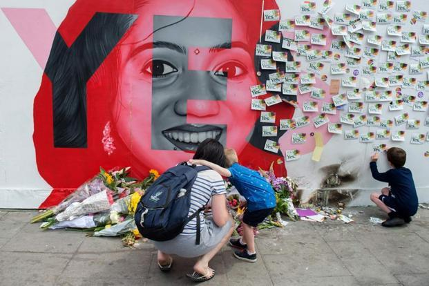 Messages and tributes left at a mural to Savita Halappanavar, on Camden Street in Dublin, Ireland, during the Irish referendum on liberalizing the abortion law. Photo: AFP