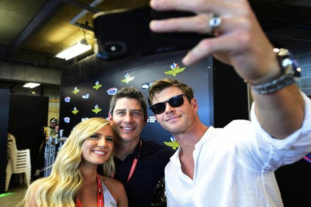 Chris Hemsworth (right) with Arie Luyendyk Jr. and Lauren Burnham. Photo: Thomas J. Russo/USA TODAY Sports