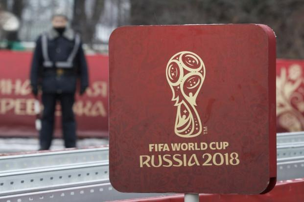 A sign with the logo of the 2018 FIFA World Cup Russia on display near the Kremlin before in central Moscow. Photo: Reuters