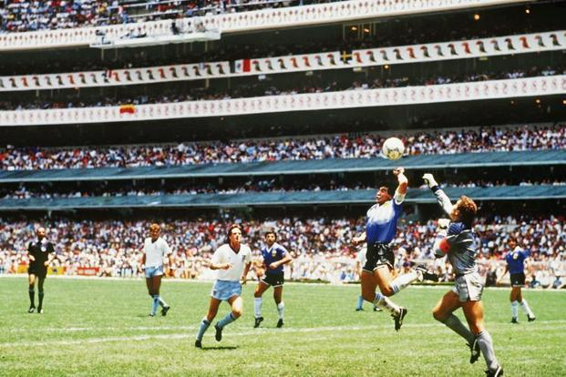 Diego Maradona handles the ball past Peter Shilton. Photo: Bongarts