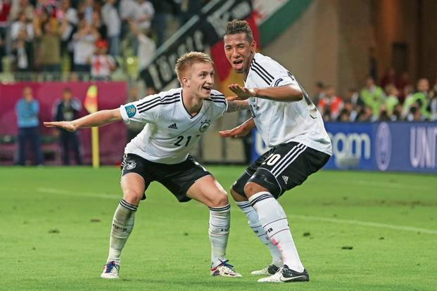 Marco Reus (left) celebrates Germany's fourth goal with Jerome Boateng during the Uefa Euro 2012 quarter-final match vs Greece. Photo: Getty Images