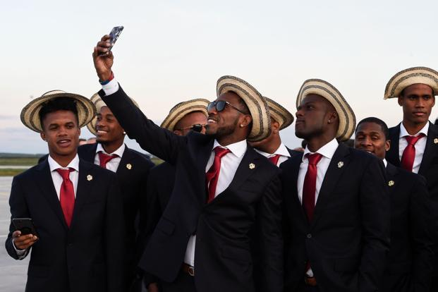 Panama's Jose Calderon (centre) poses for a selfie after disembarking from an airplane at Saransk airport on 7 June 2018, as Panama's national football team arrives ahead of the Russia 2018 FIFA World Cup. Photo: AFP