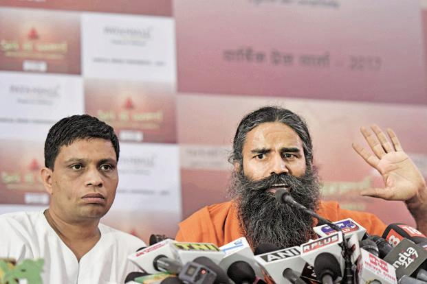 Patanjali Ayurved MD Acharya Balkrishna with Baba Ramdev. Photo: HT