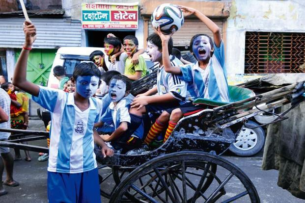 Young supporters of Germany and Argentina ahead of the 2014 FIFA World Cup final, in Kolkata. Photo: HT
