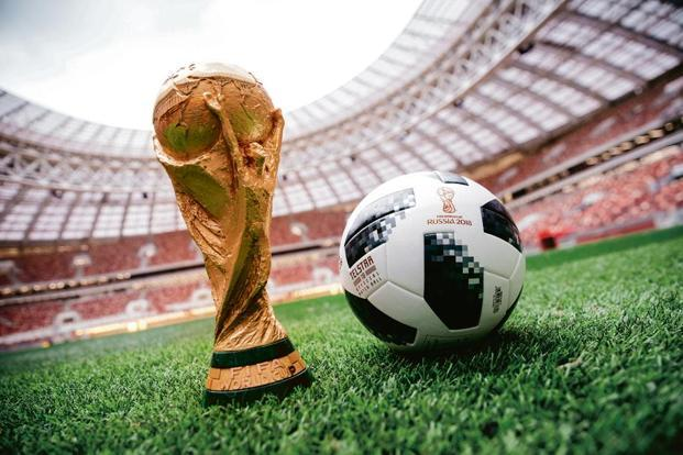 The World Cup trophy and official match ball Telstar 18. Photo: Alamy