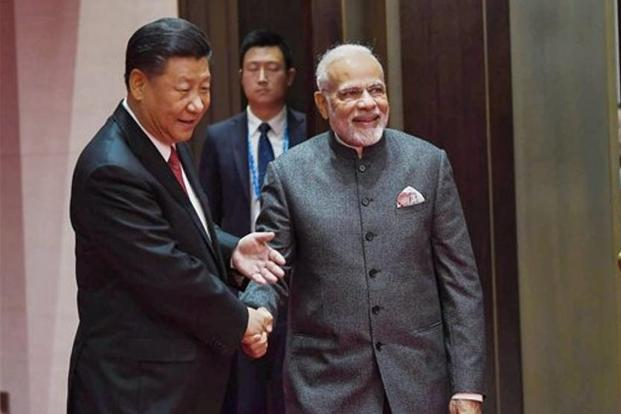 Prime Minister Narendra Modi shakes hands with Chinese President Xi Jinping during their meeting in Qingdao, China on 9 June, 2018. Photo: PTI