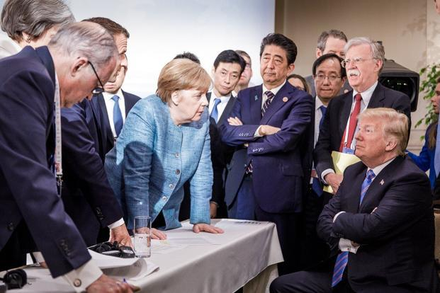 US President Donald Trump (R) with German Chancellor Angela Merkel (C) and surrounded by other G7 leaders during a meeting of the G7 Summit in La Malbaie, Quebec, Canada. Photo: AFP
