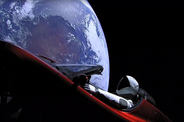 'Starman' sitting in SpaceX CEO Elon Musk's Tesla roadster after the Falcon Heavy rocket delivered it into orbit around the Earth on 2 February 2018. Photo: SpaceX via AFP