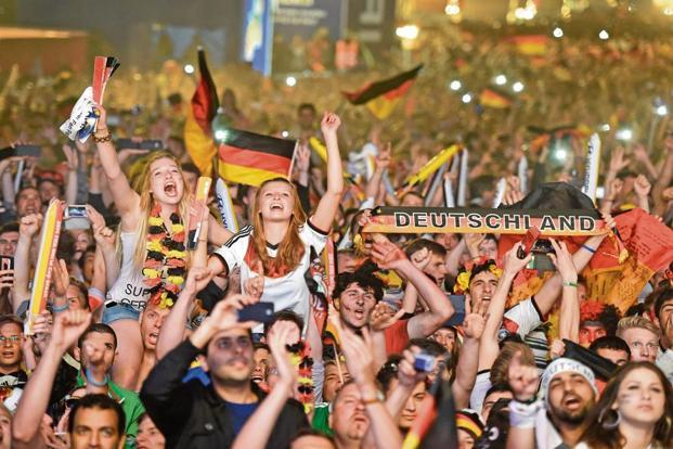 German fans celebrating as they watch the 2014 World Cup final between Germany and Argentina at a public screening of the match in Berlin. Photo: Reuters