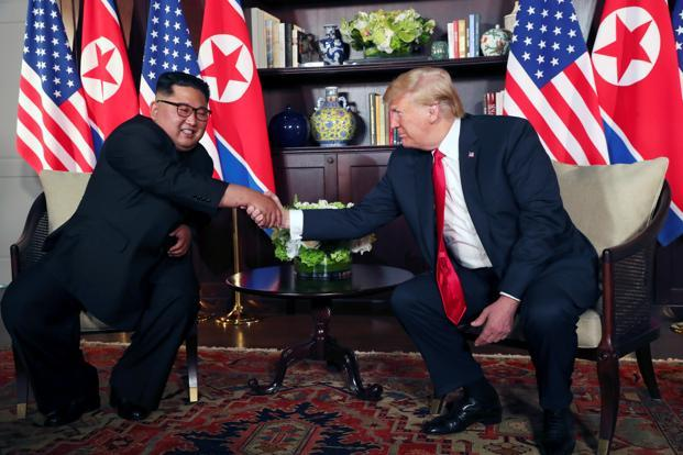 US President Donald Trump shakes hands with North Korea's leader Kim Jong Un before their summit at the Capella Hotel on Sentosa island in Singapore on Tuesday. Photo: Reuters