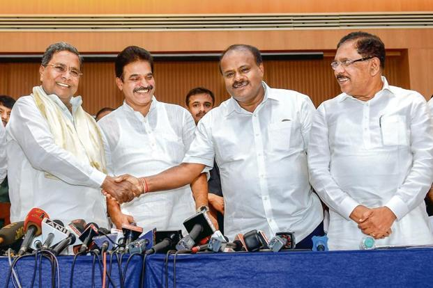 Karnataka CM H.D. Kumaraswamy (2nd from right) with coordination committee chairman K. Siddaramaiah (left). Photo: PTI.