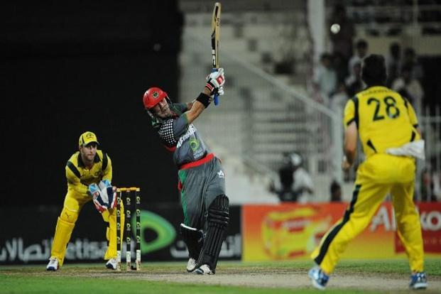 File Photo: Afghanistan's batsman Mohammad Nabi (C) hits a six as Australian wicketkeeper Matthew Wade (L) looks on during an ODI match between Afghanistan and Australia at the Sharjah cricket stadium. Photo: AFP