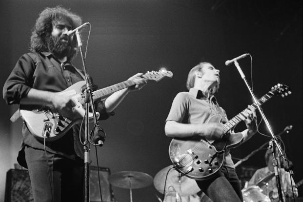 Jerry Garcia (left) and Bob Weir of the Grateful Dead perform in London in 1972. Photo: Getty Images