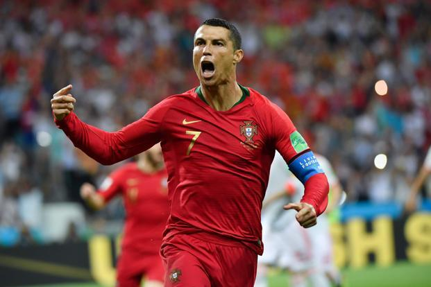 Cristiano Ronaldo celebrates a goal after shooting a penalty kick during the match against Spain at the Fisht Stadium in Sochi on 15 June