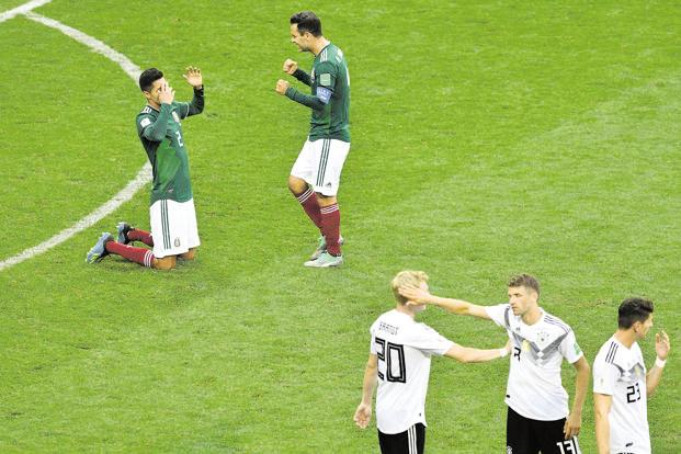 Mexico players celebrate their win over Germany in Moscow on Sunday. Photo: AFP
