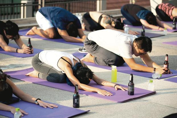 Beer, pets and surfing: Try these offbeat yoga styles ...