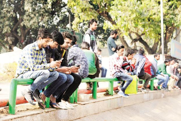 Only one in four Indian adults either owns a smartphone or uses the internet occasionally, something that the Pew Research Centre report considers to be a measure of internet penetration. Photo: Ramesh Pathania/Mint