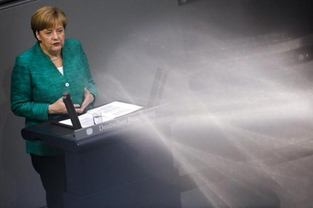 German Chancellor Angela Merkel delivers her speech amid reflections during a debate at the German parliament Bundestag in Berlin on Thursday. Photo: AP