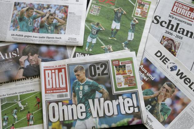 A combo of German newspapers in Berlin on Thursday after Germany was eliminated at group stage from the soccer World Cup 2018. Photo: AP