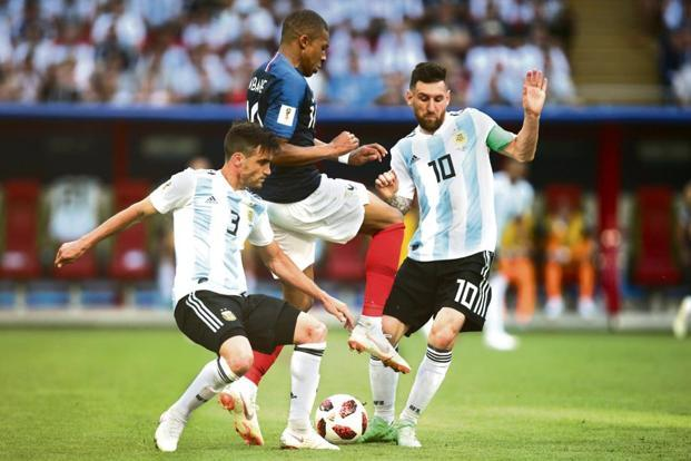 France's Kylian Mbappe (centre) and Argentina's Lionel Messi (right) in action on Saturday. Photo: AFP